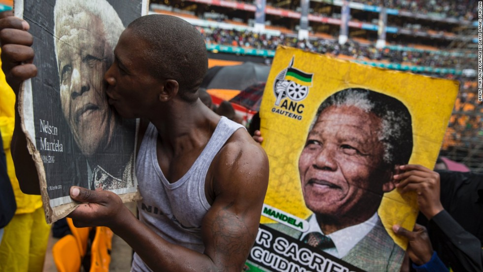 People attend the memorial service for former South African President Nelson Mandela at FNB Stadium in Johannesburg on Tuesday, December 10. Thousands of South Africans and more than 90 heads of state gathered to honor the revered leader, who died Thursday, December 5. He was 95.