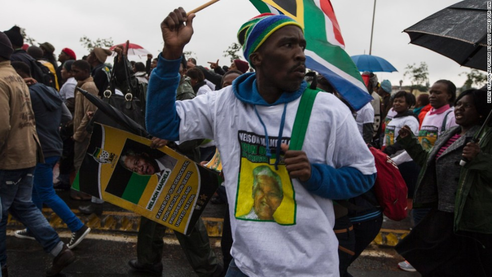 Mandela supporters make their way to the stadium.