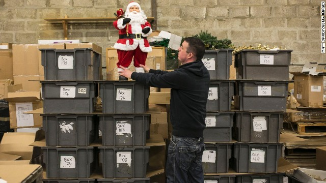 An employee with Festive Productions Ltd in Cwmbran, Wales, picks out items that will be taken to retail shows to be sold by retailers on December 10.