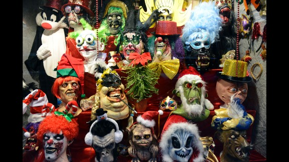 These horror masks, seen in a Madrid window display on December 9, lend a frightening air to the holiday season.