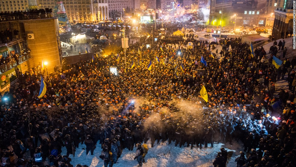 "Riot police move against protesters on Independence Square  around 2 a.m. December 11. U.S. Secretary of State John Kerry expressed ""disgust"" over the crackdown."