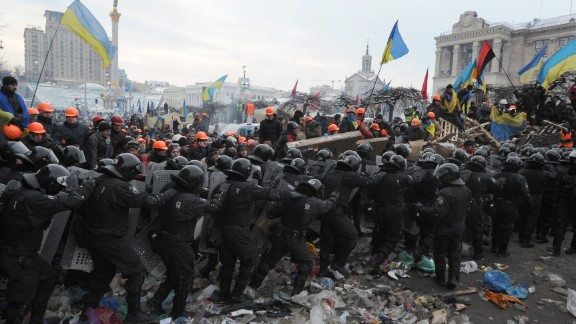 Protesters who oppose Yanukovych clash with anti-riot police in Independence Square on December 11.