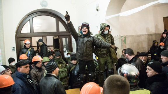 A protester calls for attention inside Kiev
