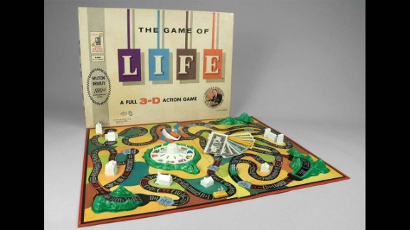 The Game of Life by Milton Bradley in 1960. Inspired by one of Milton Bradley's old Checkered Game of Life game boards from the Civil War, inventor Reuben Klamer brought the game to life to celebrate the company's 100-year history in 1960. Though the 1866 version has a similar name, the game is not centered around money; it is about virtue and morality.