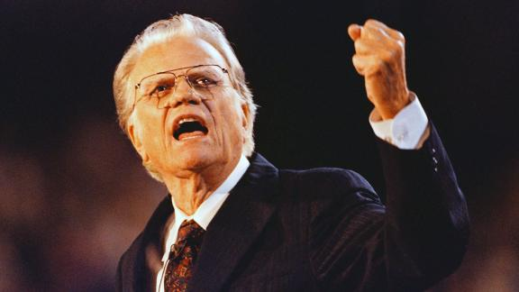 Graham gestures as he speaks to a capacity crowd at Ericsson Stadium in Charlotte, North Carolina, in 1996.