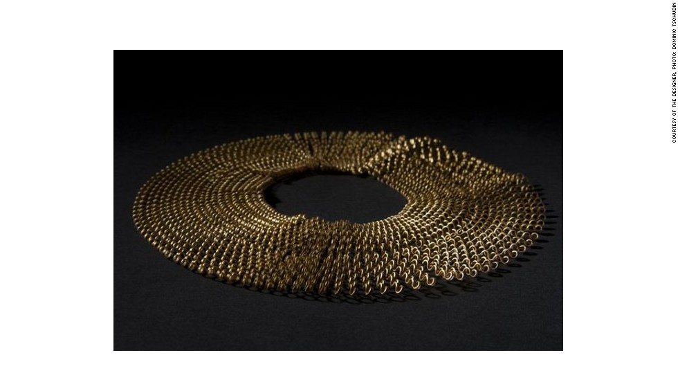 French designer Florie Salnot's recycled plastic necklace, titled <em>Plastic Gold, </em>is a product of her work with women from western Sahara. Inspired by the traditional jewelery worn by these women, Salnot has devised a craft they can practice despite their limited resources.<em> </em>
