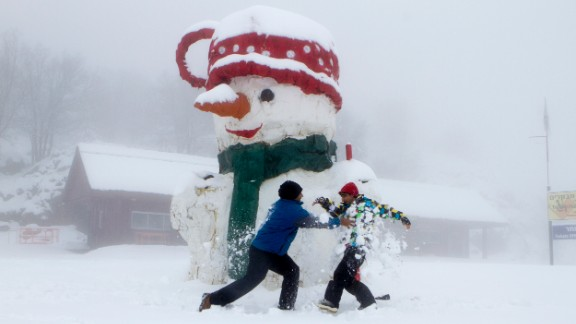 Israelis play next to a giant snowman on Mount Hermon in Golan Heights on December 11.