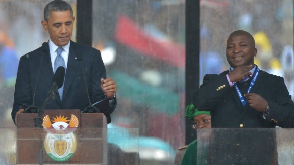 In this picture taken on December 10, 2013 US President Barack Obama delivers a speech next to a sign language interpreter (R) during the memorial service for late South African President Nelson Mandela at Soccer City Stadium in Johannesburg. South Africa's deaf community on December 11, 2013 accused the sign language interpreter at Nelson Mandela's memorial of being a fake, who had merely flapped his arms around during speeches. Mandela, the revered icon of the anti-apartheid struggle in South Africa and one of the towering political figures of the 20th century, died in Johannesburg on December 5 at age 95. AFP PHOTO / ALEXANDER JOE (Photo credit should read ALEXANDER JOE/AFP/Getty Images)