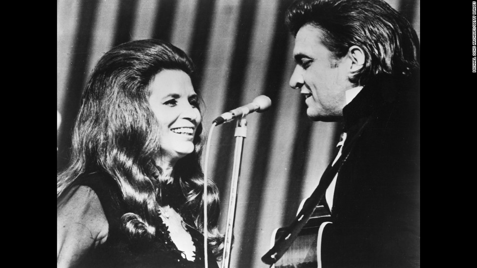 Johnny Cash and June Carter perform onstage circa 1970.