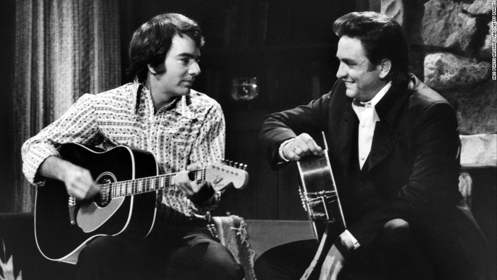 "Cash, right, and Neil Diamond appear on ""The Johnny Cash Show"" aired on February 11, 1970."