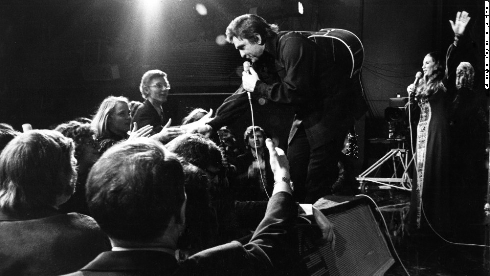 Cash performs live with June Carter Cash in Amsterdam, Netherlands, in 1972.