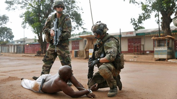French troops detain a suspected Seleka officer -- preventing a Christian mob from lynching him -- in Bangui on Monday, December 9. The mission of the peacekeeping force is to protect civilians in the Central African Republic, restore humanitarian access and stabilize the country.