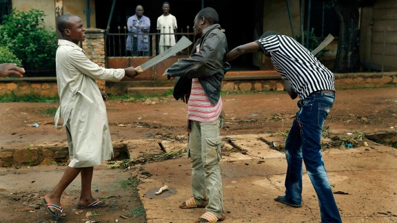Muslim men rough up a Christian man while checking him for weapons December 13 in Bangui.