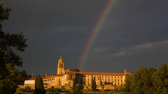 A rainbow forms over the Union Buildings in Pretoria on Thursday, December 12, after the public viewing of Mandela's casket.