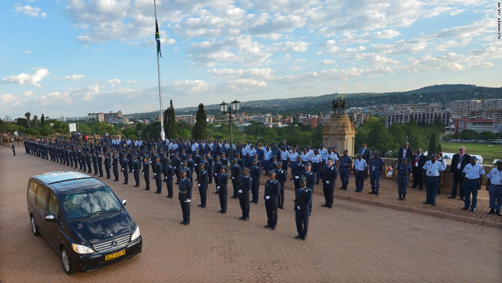 The hearse carrying former South African President Nelson Mandela leaves the Union Buildings after the final day of his lying in state in Pretoria, South Africa, on Friday, December 13.