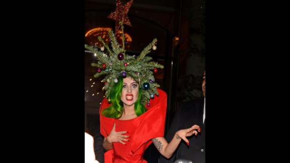 Pop singer Lady Gaga wears a real Christmas tree as a hat while returning to her hotel following the Jingle Bell Ball at London's O2 Arena on December 9.