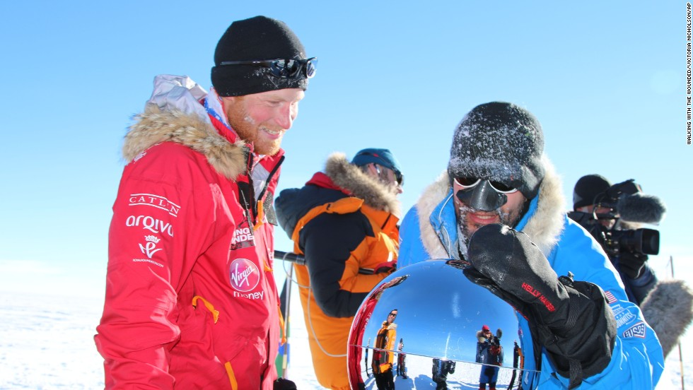 Britain's Prince Harry, left, and Ivan Castro, touch the pole, as they and their fellow adventurers reach the South Pole, as part of their Walking With The Wounded charity trek, Friday, December 13. After more than three weeks pulling sleds across more than 300 kilometers of Antarctica, the group stood at the bottom of the world at midday.