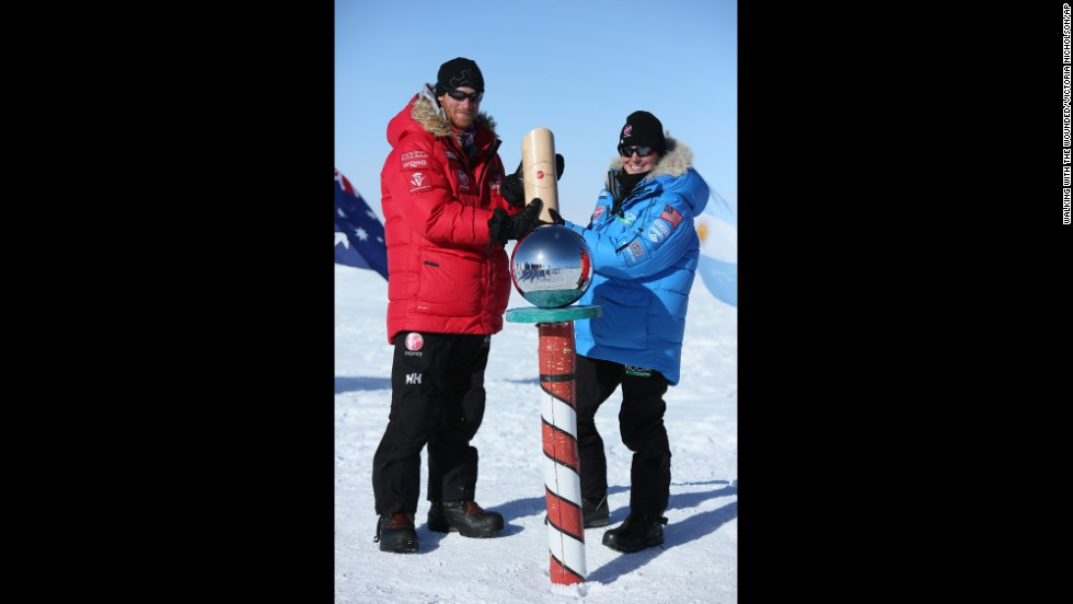 Britain's Prince Harry, left, and Margaux Mange of Team U.S. at the South Pole.