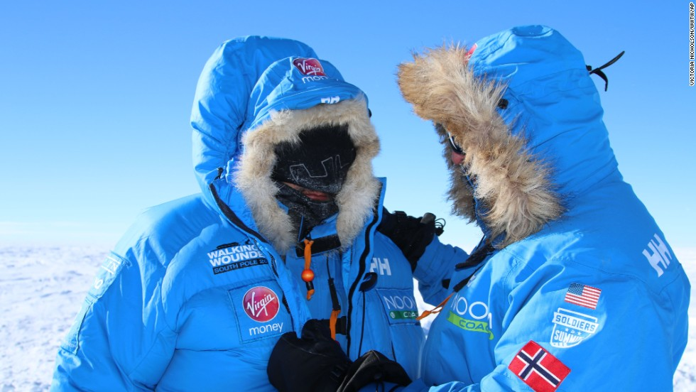 Two unidentified members of Team U.S. chat on the first day of the 200-mile expedition to the South Pole alongside wounded service personnel. Team U.S. is one of three teams competing in the trek to raise money for Walking With The Wounded.