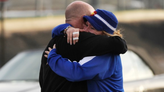 Susie Ohle hugs Rob Escue as he came out of the school on Friday afternoon.