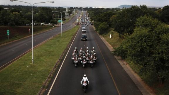 Motorcycles escort Mandela