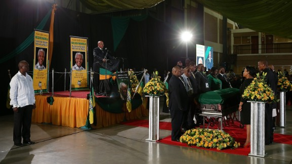 South African President Jacob Zuma speaks during an African National Congress-led alliance send-off ceremony at Waterkloof air base in Pretoria before the final journey of Mandela