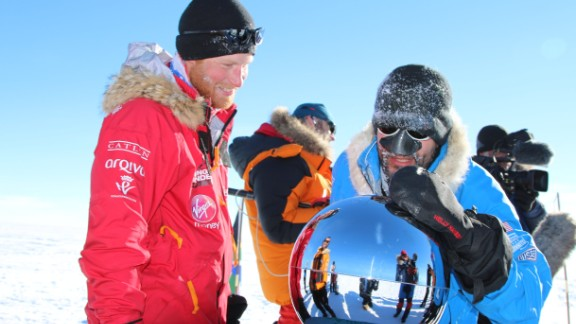 Prince Harry, left, and Ivan Castro touch the pole as they and their fellow adventurers reach the South Pole as part of their Walking With the Wounded charity trek on Friday, December 13, in Antarctica. The Virgin Money South Pole Allied Challenge 2013, of which Prince Harry is patron, will see the participants race across three degrees to the South Pole.