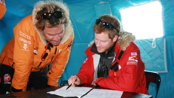 Prince Harry and Dominic West make notes on how much each individual and their kit weight.