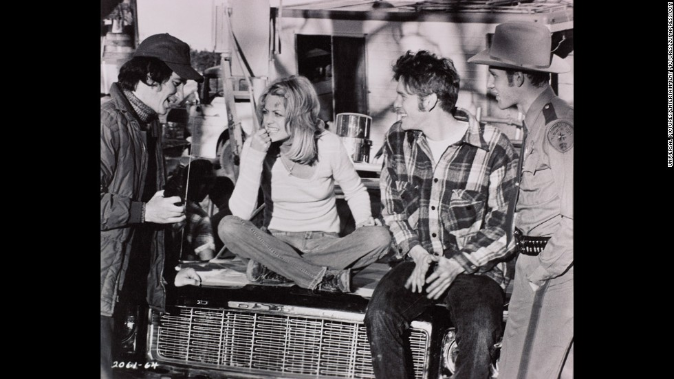 "Spielberg, left, talks with actors Goldie Hawn, William Atherton and Michael Sacks on the set of his 1974 film ""The Sugarland Express."" Prior to that, Spielberg had directed television shows and made-for-TV movies. Spielberg's first film in 1964, ""Firelight,"" was about UFOs attacking a town."