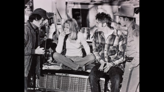 """Spielberg, left, talks with actors Goldie Hawn, William Atherton and Michael Sacks on the set of his 1974 film """"The Sugarland Express."""" Prior to that, Spielberg had directed television shows and made-for-TV movies. Spielberg's first film in 1964, """"Firelight,"""" was about UFOs attacking a town."""