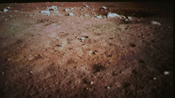 Apicture of the surface of the moon was taken by the on-board camera of China's lunar probe Chang'e-3 is seen on the screen of the Beijing Aerospace Control Center in Beijing, capital of China.