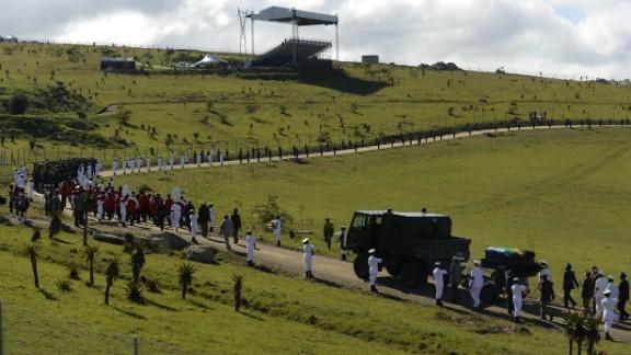 The casket arrives for the ceremony in Qunu on December 15.