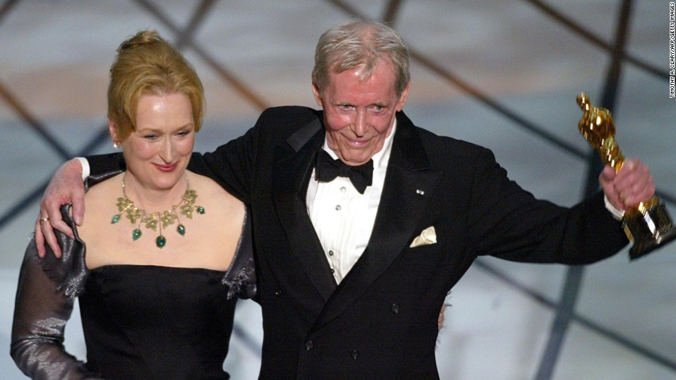 "O'Toole accepts his honorary Oscar from actress Meryl Streep during the 75th Academy Awards in 2003. The engraving on the gold statuette reads: ""Whose remarkable talents have provided cinema history with some of its most memorable characters."""
