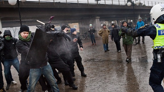 Police try to stop right-wing extremists from attacking an anti-nazi demonstration in Stockholm on December 15.