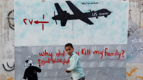 A Yemeni boy walks past a mural depicting a U.S. drone on December 13 in the capital Sanaa.