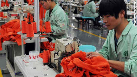 his picture taken on November 16, 2013 shows workers sewing in a clothing factory in Bozhou, east China's Anhui province. China's quick release of a surprisingly detailed national reform plan shows leaders are serious about economic change, analysts say, though uncertainties shadow its execution. CHINA OUT AFP PHOTO (Photo credit should read STR/AFP/Getty Images)