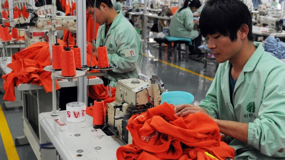 Workers sewing in a clothing factory in Bozhou, in east China's Anhui province.