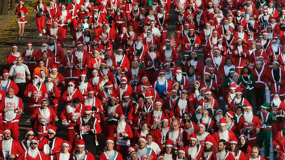 About 6,000 people dressed up as Santa Claus and his elves to run in the Madrid mini-marathon.