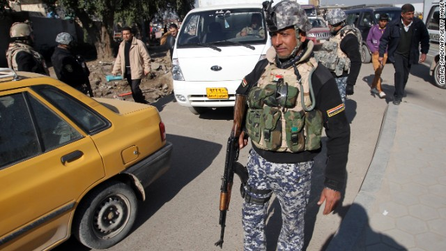 A member of the Iraqi security forces monitors a checkpoint in Baghdad on December 16, 2013.