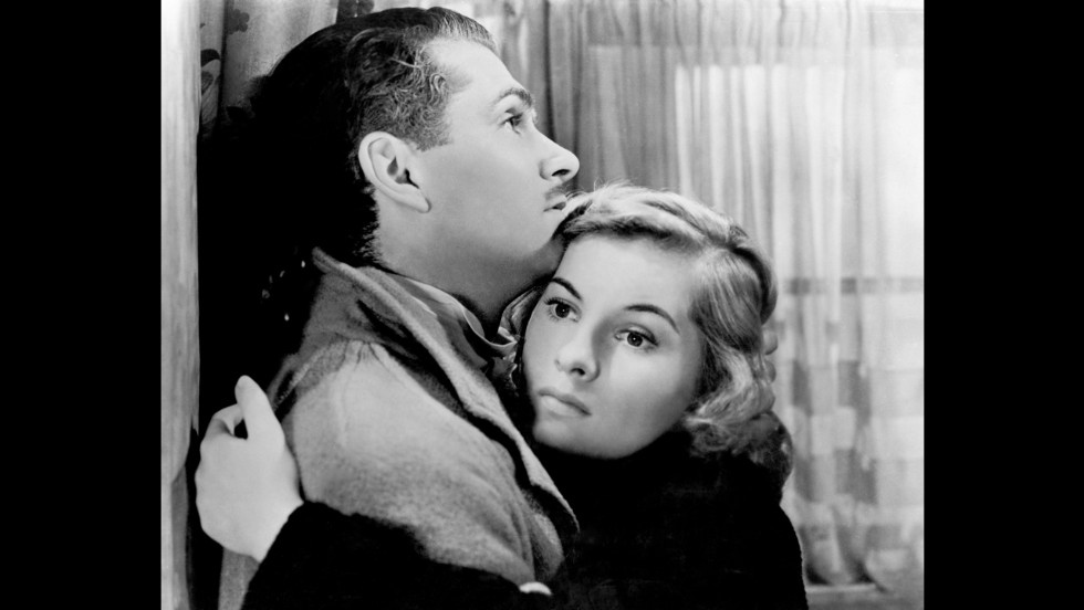 "Fontaine and Laurence Olivier embrace in ""Rebecca,"" a 1940 film directed by Alfred Hitchcock. For her role in ""Rebecca,"" Fontaine earned her first Academy Award nomination for Best Actress."