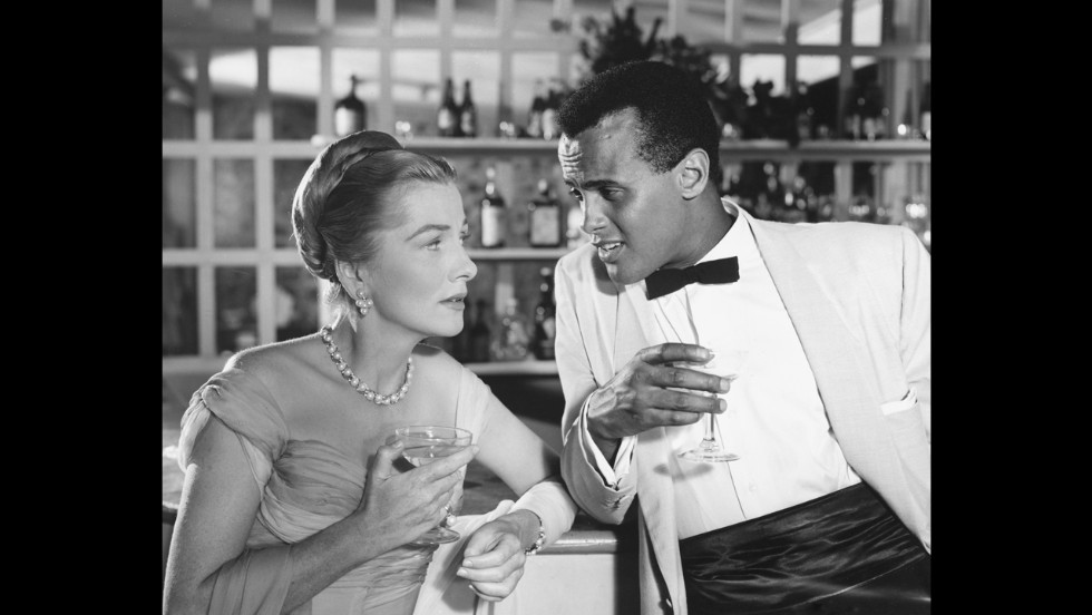 "Fontaine and Harry Belafonte appear in the 1957 film ""Island In the Sun."""