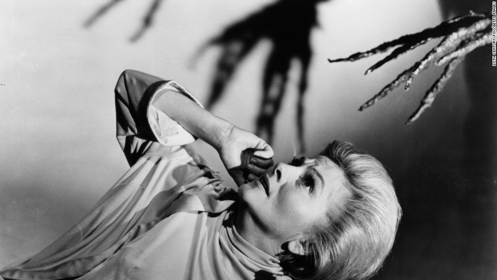 "Fontaine appears scared of the branch-like hand coming at her in a scene from the 1966 film ""The Devil's Own."""