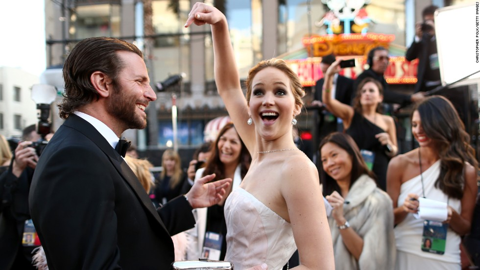 "Jennifer Lawrence (seen here with ""Sliver Linings Playbook"" and ""American Hustle"" co-star Bradley Cooper) couldn't have been more popular in 2013 as both the star of ""The Hunger Games"" films and<a href=""marquee.blogs.cnn.com/2013/11/12/jennifer-lawrence-is-still-everything/""> the coolest person on the planet. </a>"