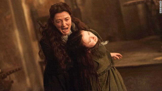 "Catelyn Stark (Michelle Fairley) seizes Walder Frey's wife (Kelly Long) in an episode of  ""Game of Thrones."""