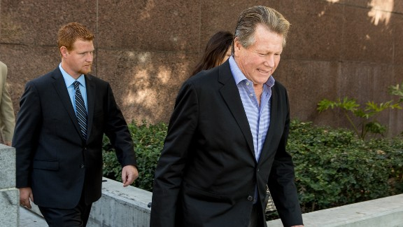 Actor Ryan O'Neal, center, and son, Redmond O'Neal, exit court for a lunch break on Thursday, December 12, 2013, in Los Angles.