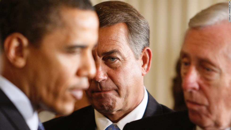 Boehner, center, looks on as President Barack Obama speaks with then-House Majority Leader Steny Hoyer in the East Room of the White House on February 23, 2009. Boehner and Obama have butted heads over the years.