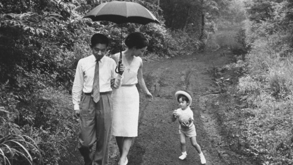 Prince Akihito takes a walk with Princess Michiko and their son Naruhito in 1964.