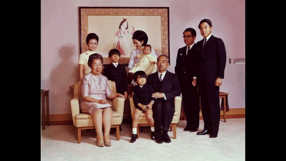 In a 1969 portrait, Emperor Hirohito and Empress Nagako pose with their children and grandchildren. Crown Prince Akihito stands on the far right.
