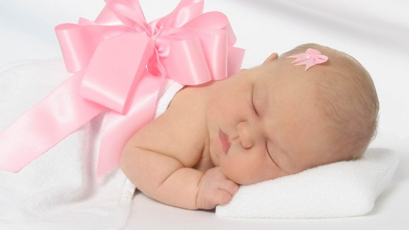 Cora McCormick died of a congenital heart defect at only 5 days old. Her mom  lights five flameless candles at Christmas.