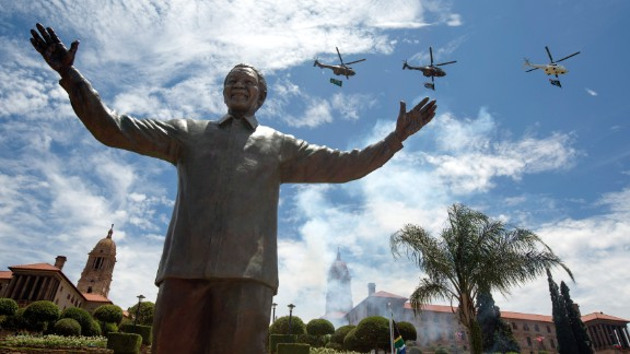 PRETORIA, SOUTH AFRICA - DECEMBER 16: A military fly-past takes place above a statue of former South African president Nelson Mandela shortly after its unveiling at the Union Buildings on December 16, 2013 in Pretoria, South Africa. South African president Jacob Zuma unveiled a 9 meter bronze statue of former South African president Nelson Mandela as part of the Day of Reconciliation celebrations. (Photo by Oli Scarff/Getty Images)